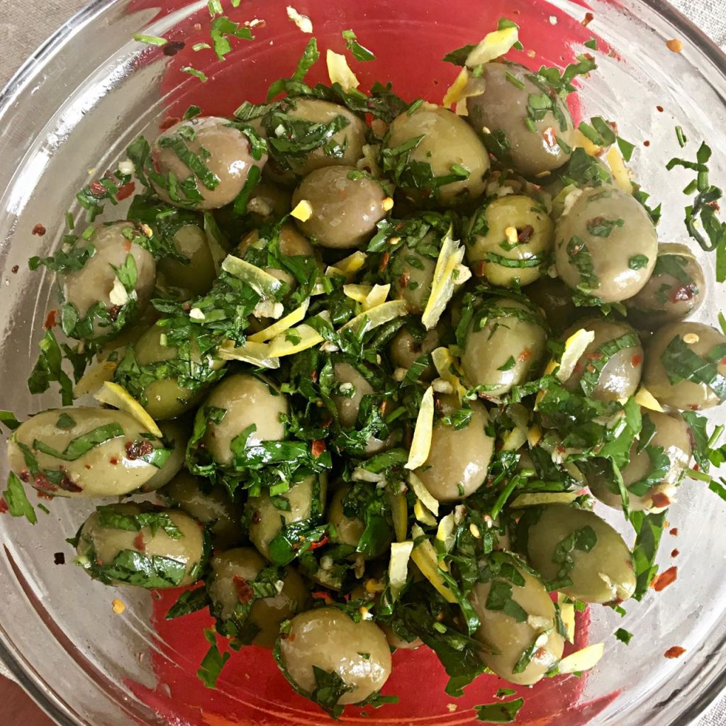 Olives Marinated with Herbs, Garlic and Preserved Lemon | cookglobaleatlocal.com