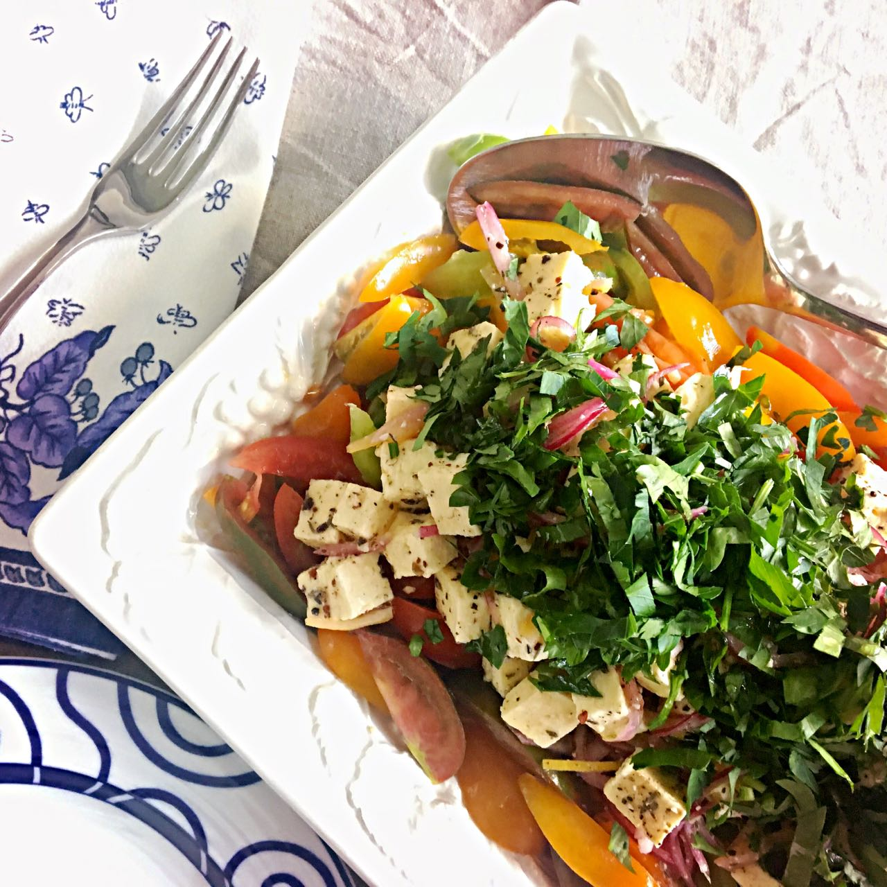 Mediterranean Tomato Salad with Onion, Spiced Feta, and Preserved Lemon