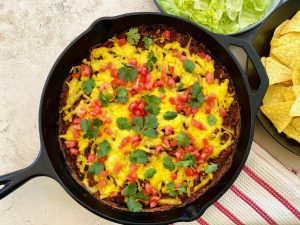 Spicy Refried Bean Taco Skillet | cookglobaleatlocal.com